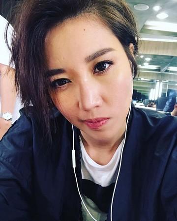 ▲A-Lin短髮削到耳上。(圖/翻攝自A-Lin臉書)