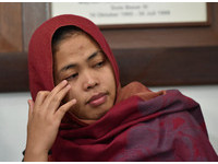馬來西亞高等法院於3月11日撤銷印尼籍25歲女艾莎(Siti Aisyah)暗殺金正男的指控。(圖/路透社)