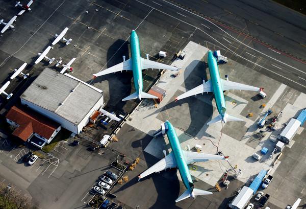 ▲▼  美國波音公司在華盛頓州倫頓(Renton)的工廠,停放多架737MAX機型飛機。(圖/路透)