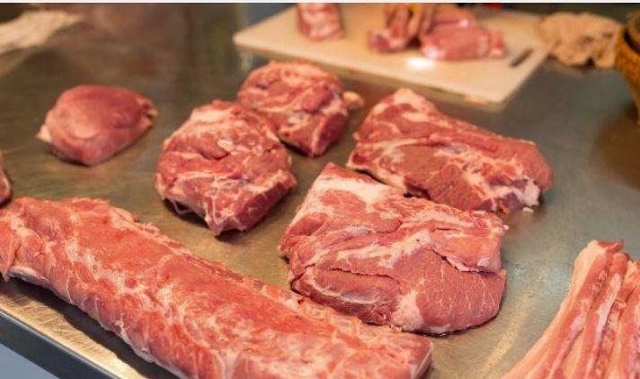 ▲▼菜市場豬肉攤商。(圖/翻攝自微博)