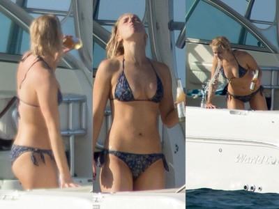 珍妮佛勞倫斯度假曬八字豪乳 喝酒狂吐海中未免太豪放