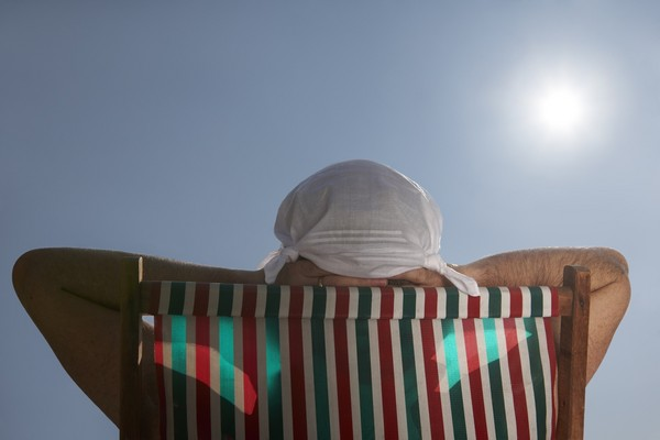 太陽,曬太陽,日光浴。(圖/達志/示意圖)