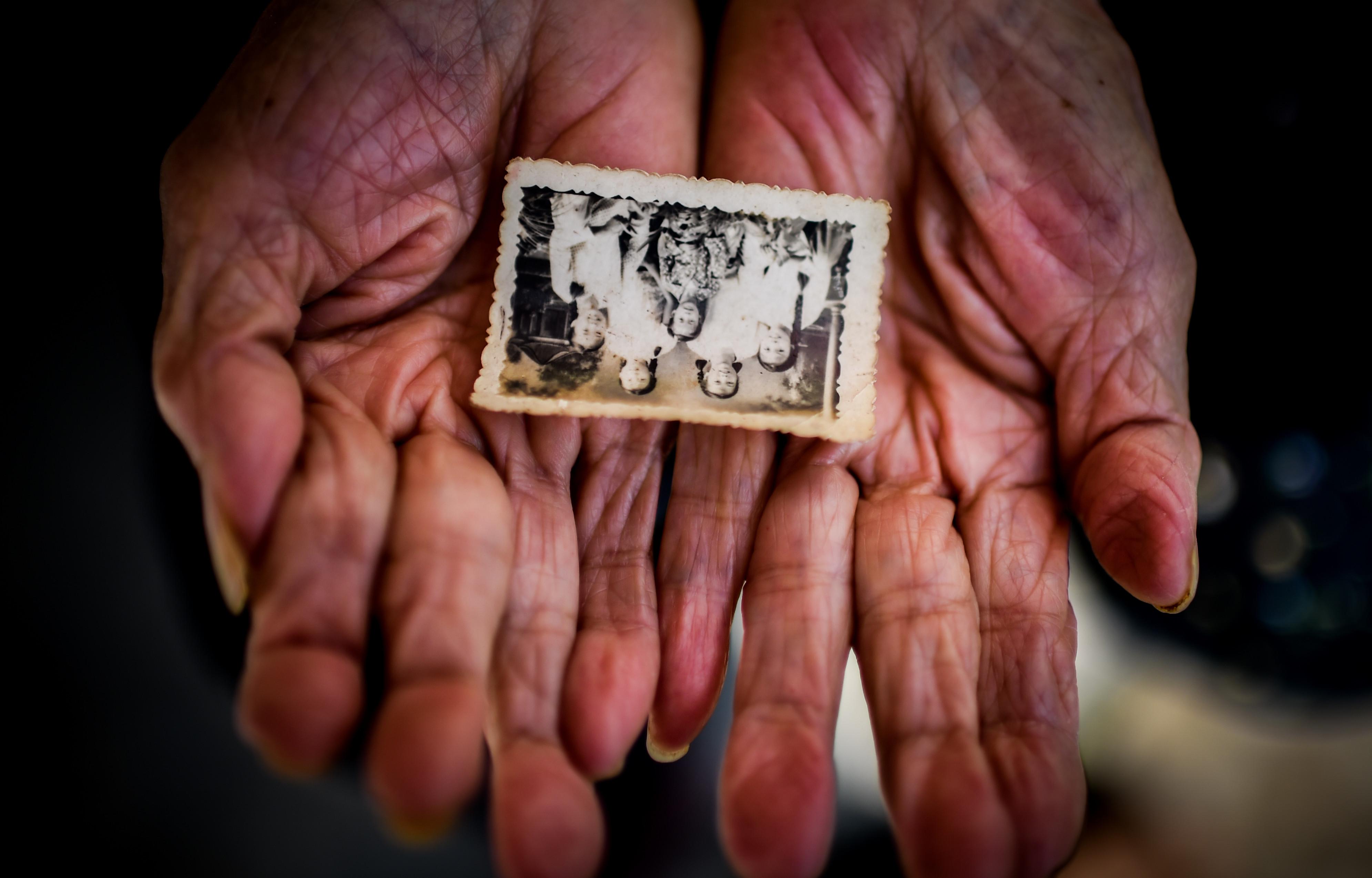 ▲百歲老人李玉珍從41歲開始學攝影,一堅持便是64年。(圖/取自CFP)