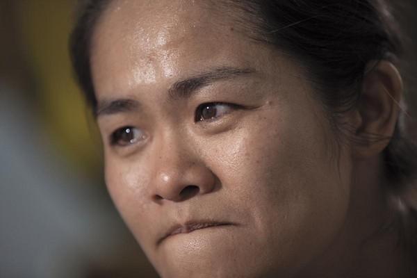 講起受傷的小兒子,李沂忍不住雙眼含淚。