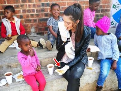 戴手套發食物給愛滋病童 鄉民嗆南非小姐「歧視」反被圍剿