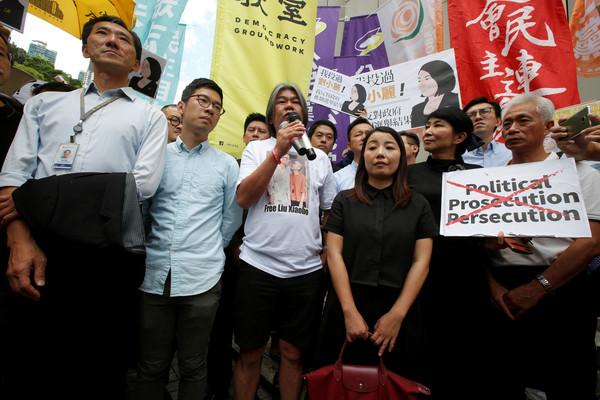▲香港「泛民主派」立法會議員梁國雄、姚松炎、劉小麗和羅冠聰被褫奪議員資格。(圖/路透社)