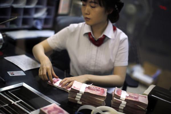 ▲▼大中華跨境中文匯款從2013年就開始實施。(圖/路透社)