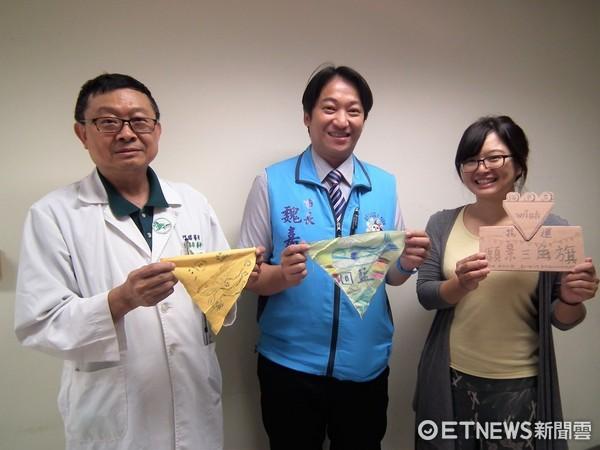 花蓮願景三角旗的製作,花蓮市長魏嘉賢畫出對花蓮的願景,呼籲大家對環保生態的重視。(圖/花蓮市公所提供)