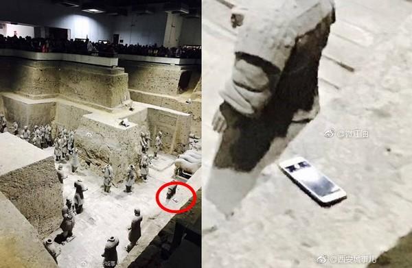 ▲遊客在參觀兵馬俑時,手機不小心掉下去。(圖/翻攝自西安城事兒微博)