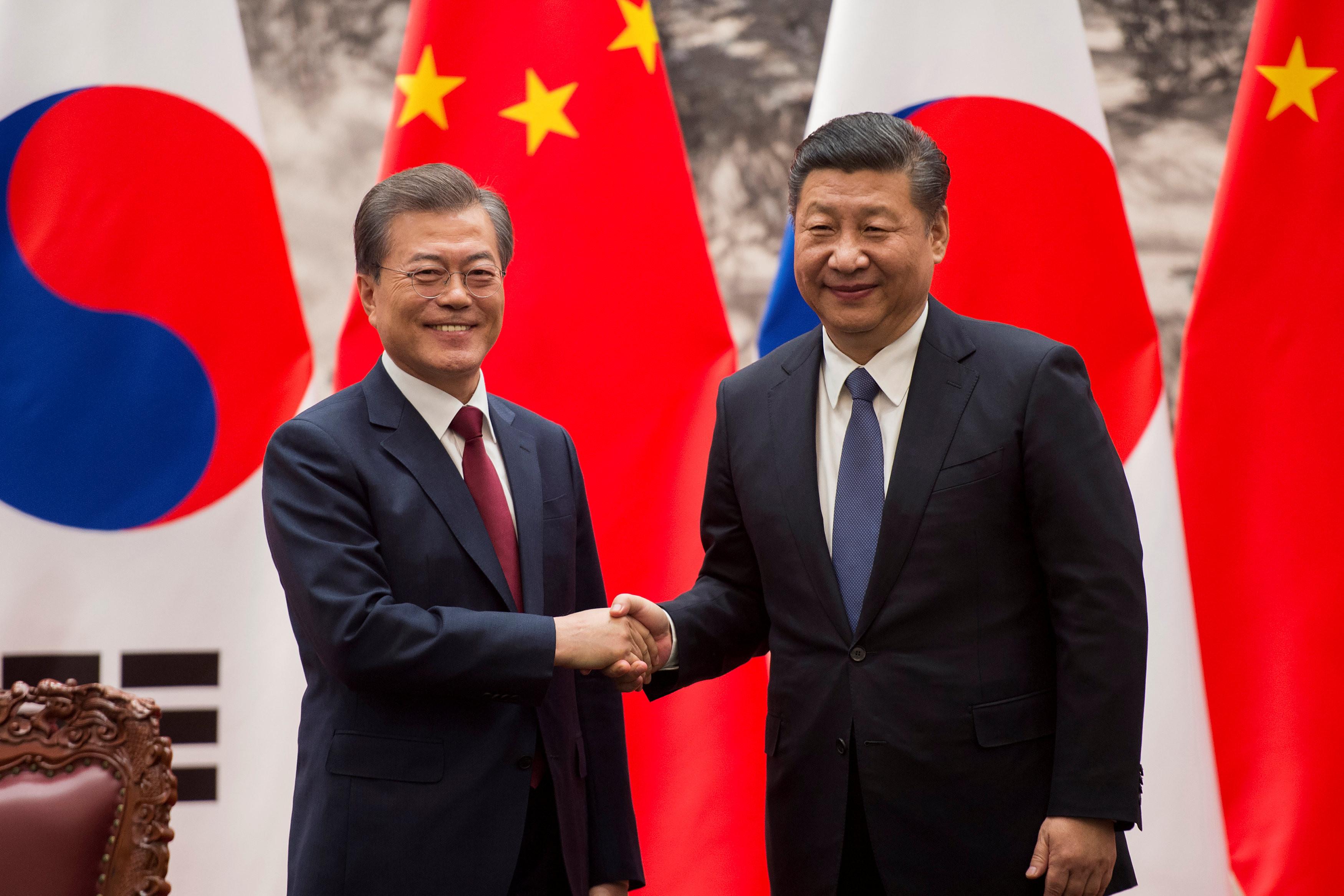 ▲中國國家主席習近平、南韓總統文在寅。(圖/路透社)