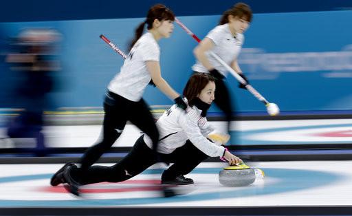 ▲冬奧日本女子冰壺隊 。(圖/達志影像/美聯社)