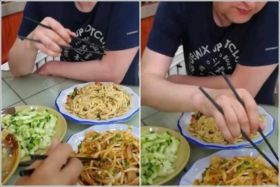 ▲一名外國人拿筷子的樣子超級特別,而且竟然可以夾食物。(圖/翻攝自爆笑公社)