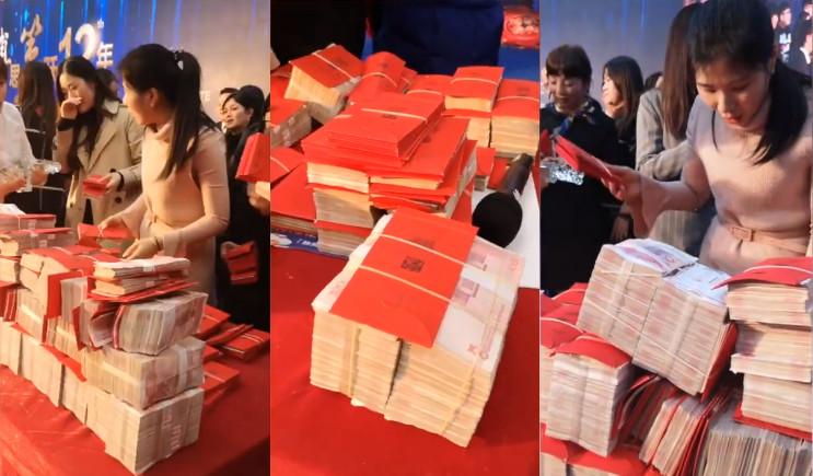 ▲▼浙江杭州房地產公司「堆鈔票山」發2.2千萬年終 「最強員工」可抱167萬回家。(圖/翻攝梨視頻)