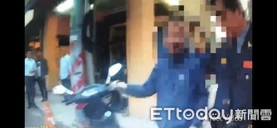 男子酒駕攔車揮拳鬧事 員警壓制上銬