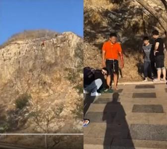 霸氣哥重摔30米山崖 起身後抽菸