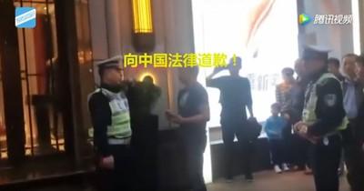 上海交警要求日本男子向中國法律道歉