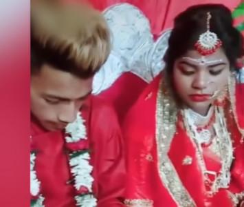 新郎婚禮低頭打電動 新娘無奈斜瞄