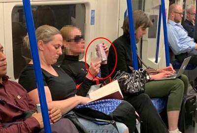 地鐵啜飲粉紅酒 她還自備玻璃杯