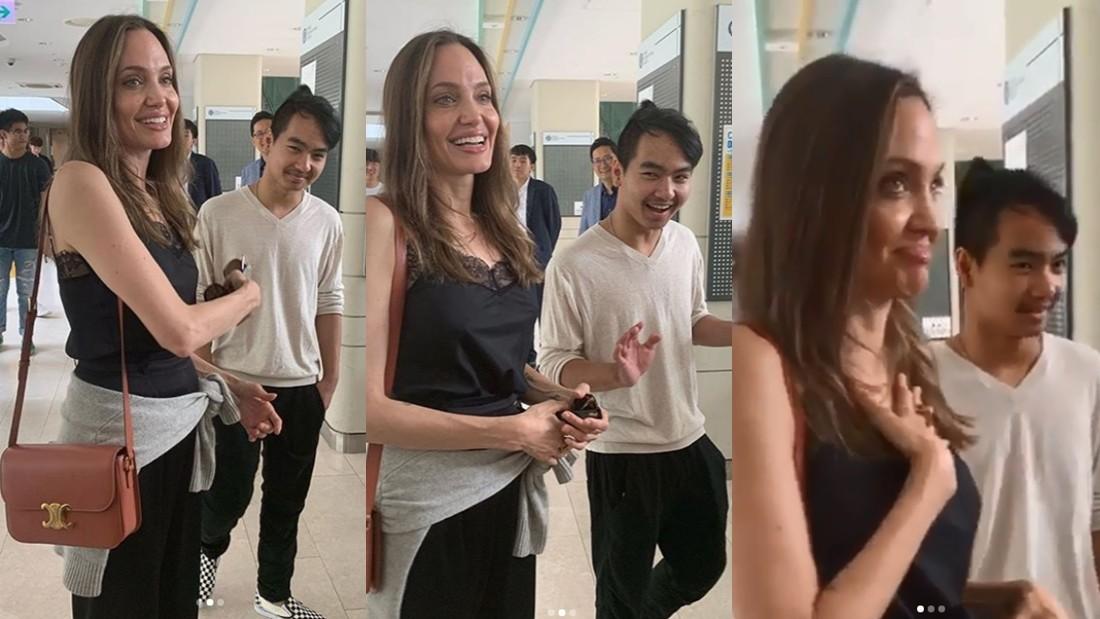 ▲安潔莉娜裘莉和學生們聊天,提到當天就要離開南韓時擺出難過表情。(圖/翻攝自Instagram)