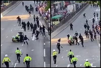港警騎車「3度衝向示威者」 2黑衣人倒地受傷