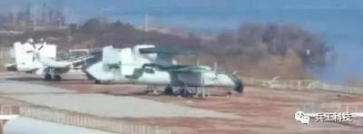 全新艦載固定機現身武漢航母樓