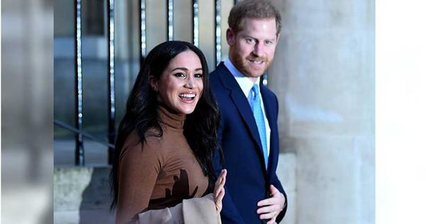哈利王子與妻子梅根。(圖/路透)