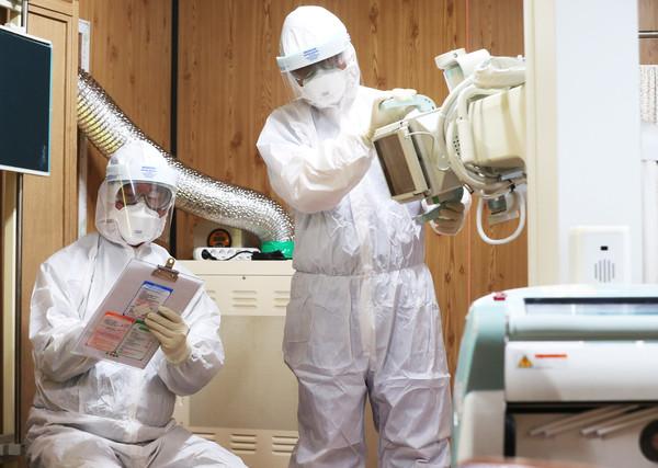 ▲▼新型冠狀病毒感染肺炎。武漢肺炎,疫情,口罩。(圖/路透)
