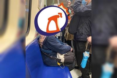 超狂台北女 自製「防毒頭盔」搭捷運