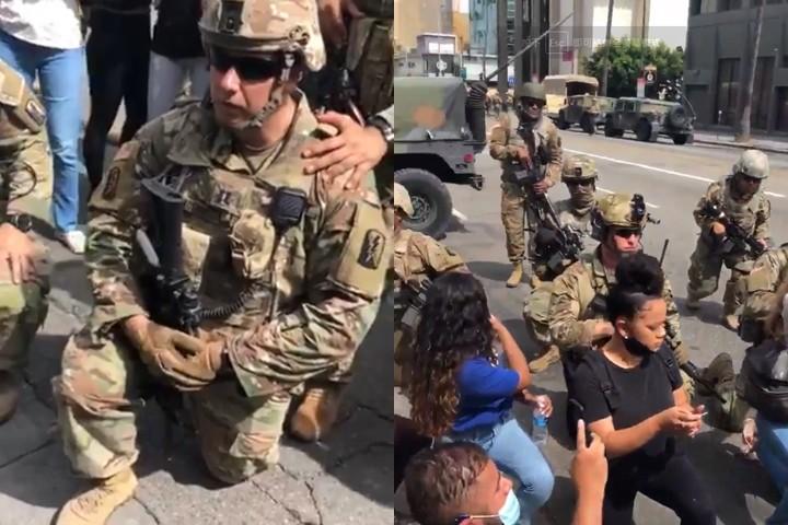 ▲▼洛杉磯國民兵「單膝跪地」向示威民眾致意。(圖/翻攝自Twitter@marcella)