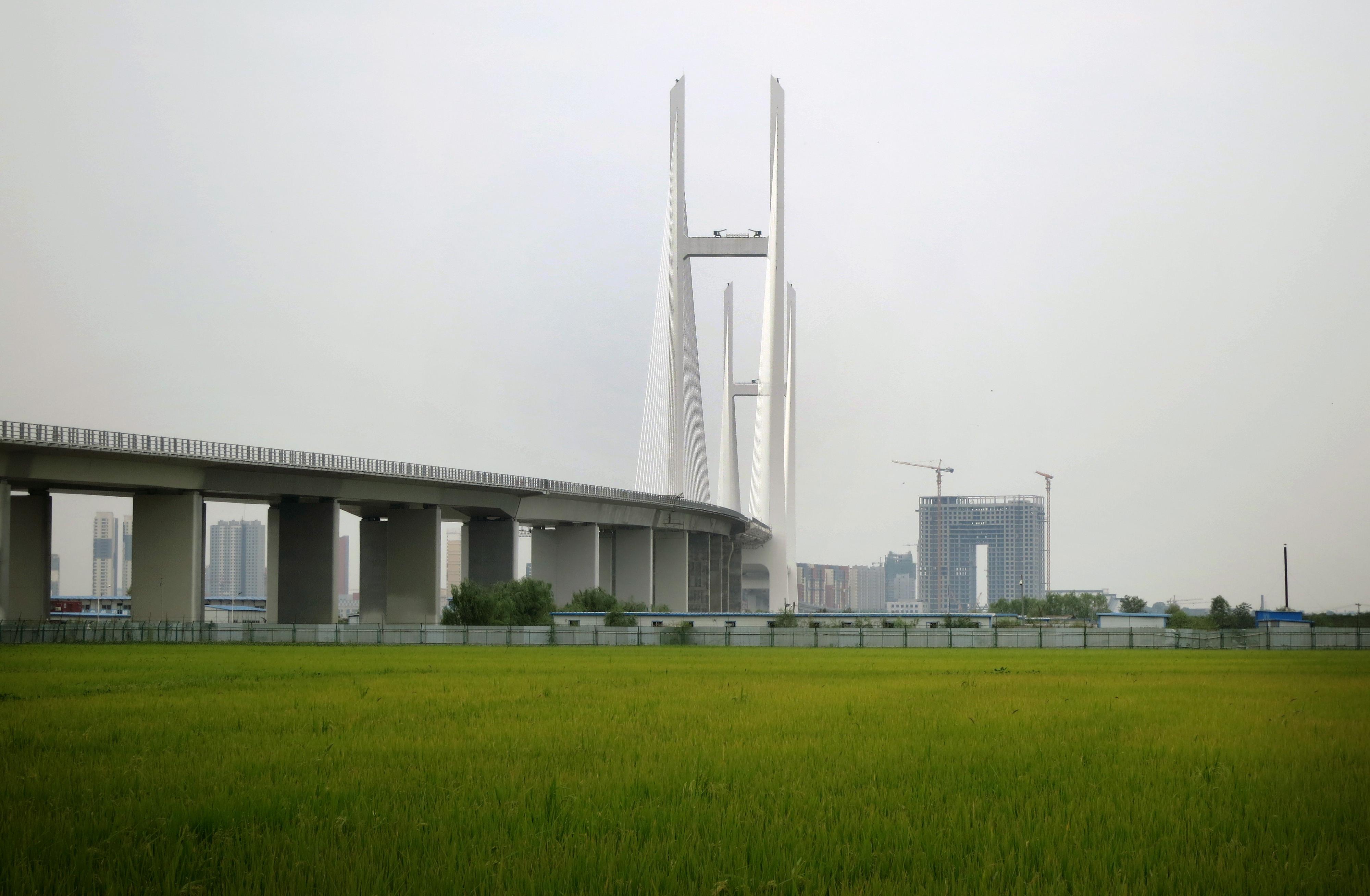 ▲▼連接中國遼寧省丹東與北韓新義州的新鴨綠江大橋。(圖/達志影像/美聯社)