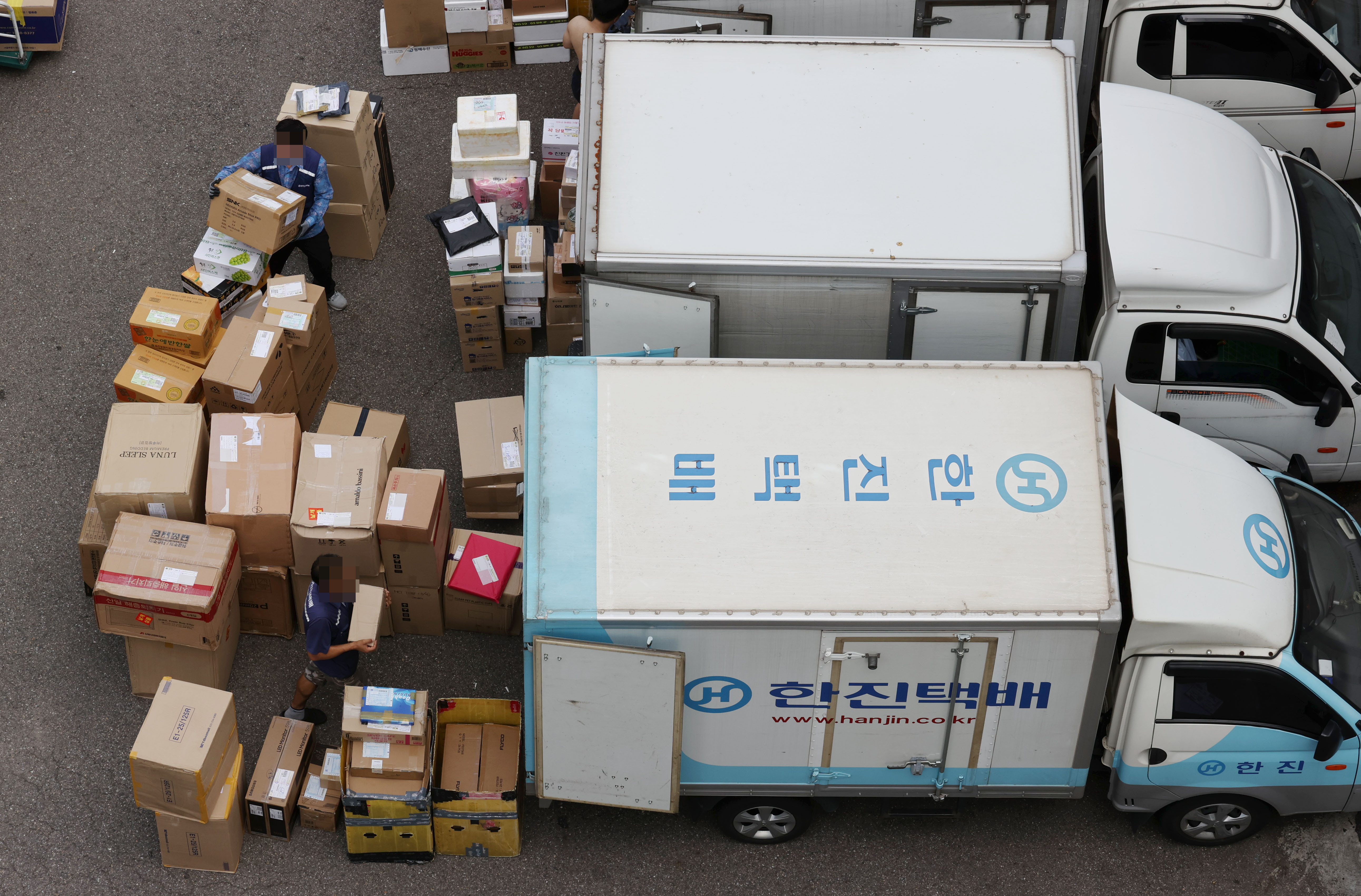 ▲▼南韓宅配司機工會表示,將暫時撤回21日罷工決定。(圖/達志影像)