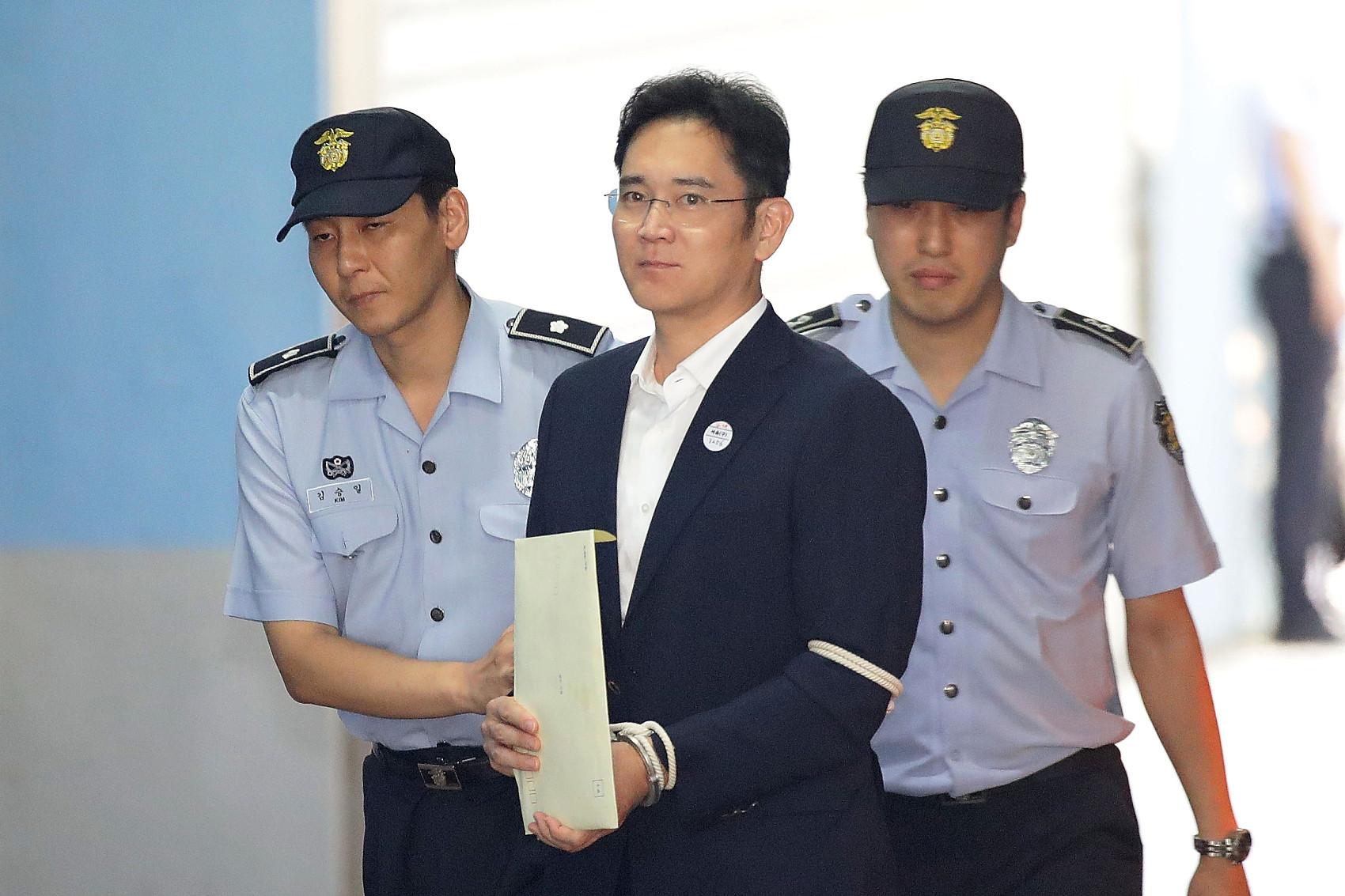 ▲▼三星少主李在鎔一審時被首爾中央地方法院判處5年徒刑,當庭羈押。(圖/CFP)