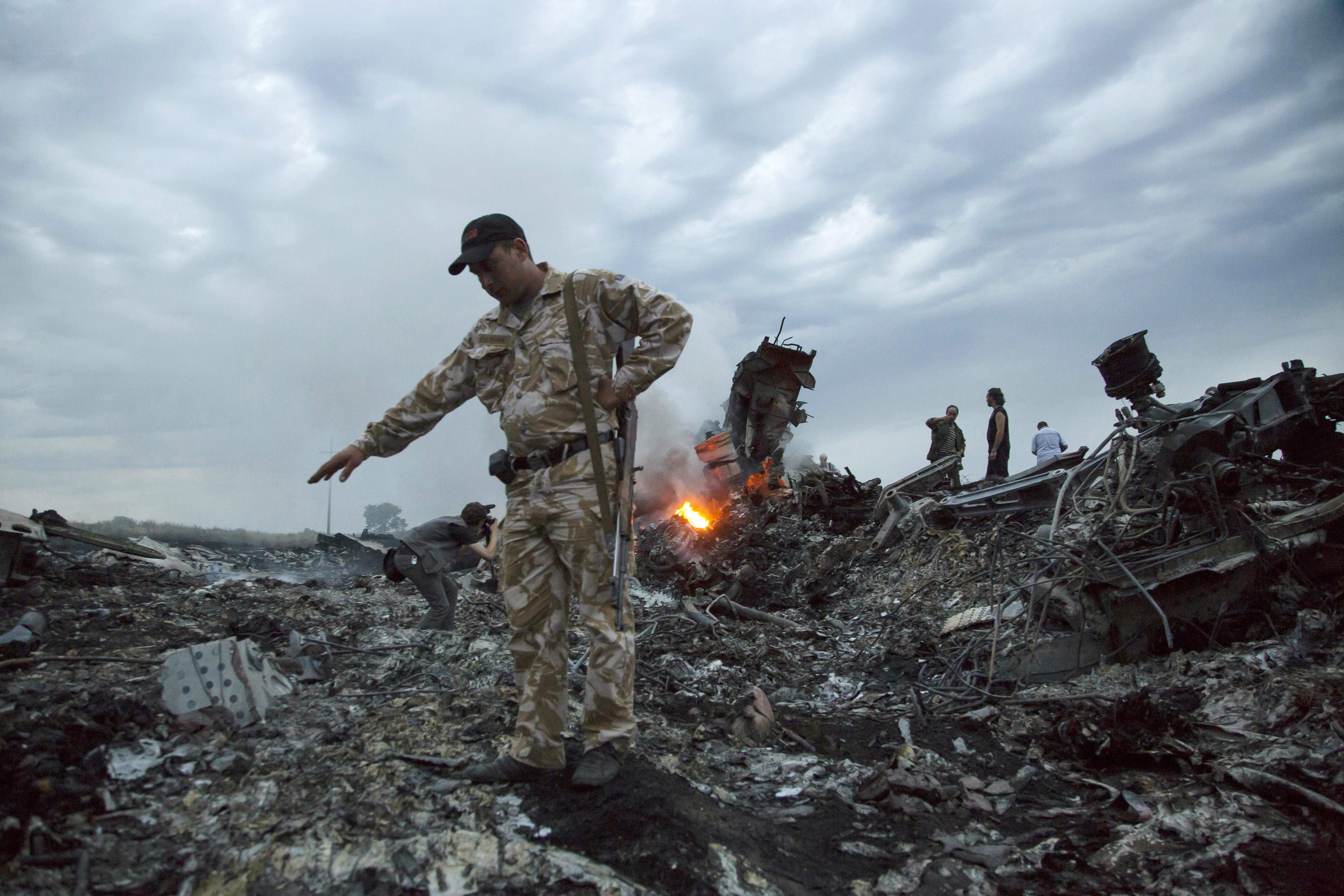 ▲▼馬航MH17班機在烏克蘭東部遭飛彈擊落,此後美政府禁止該國航空業者在該地進行民航活動。(圖/達志影像/美聯社)