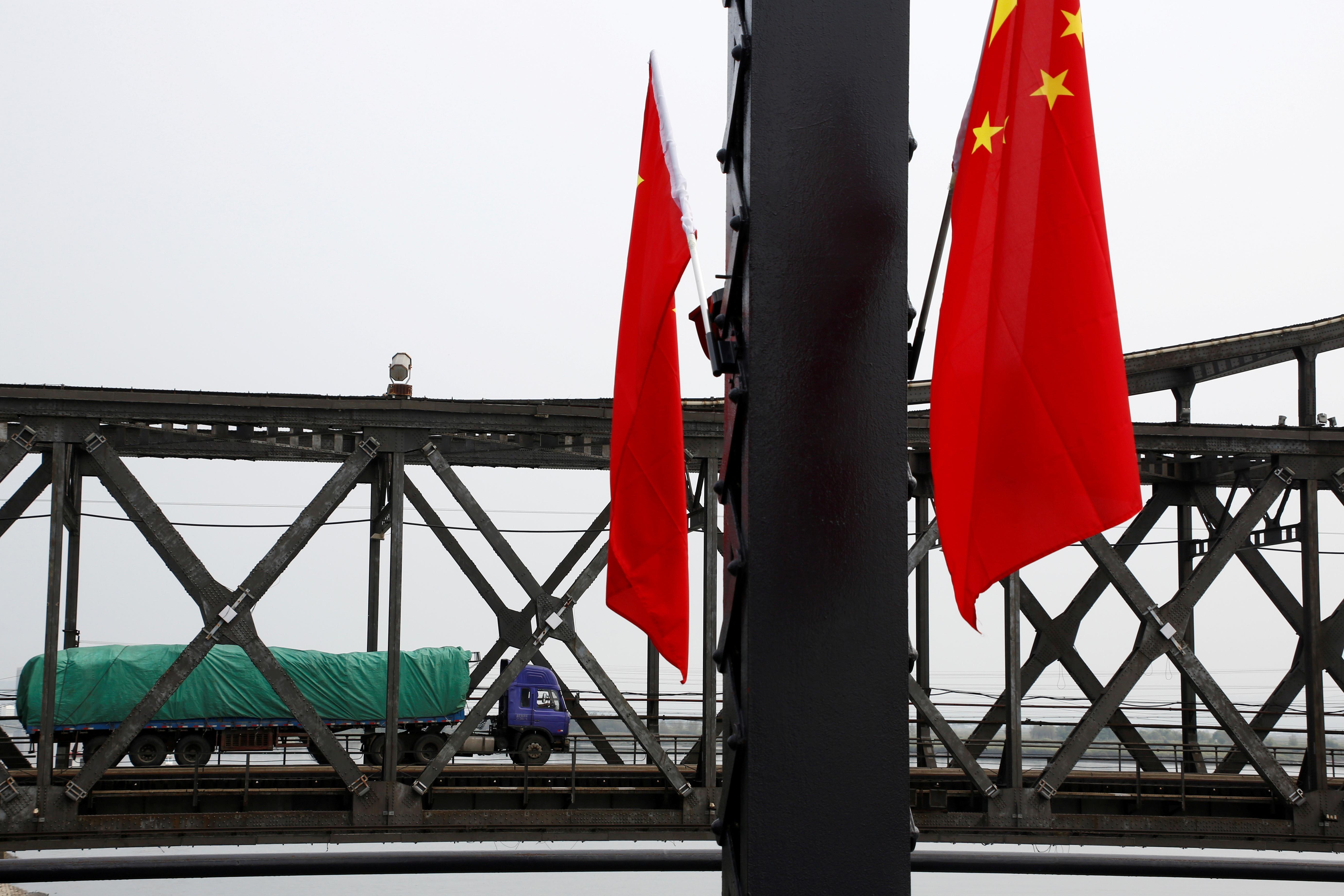 ▲▼隨著疫情爆發,來往北韓、中國的貨車通行量減少88%。(圖/路透社)
