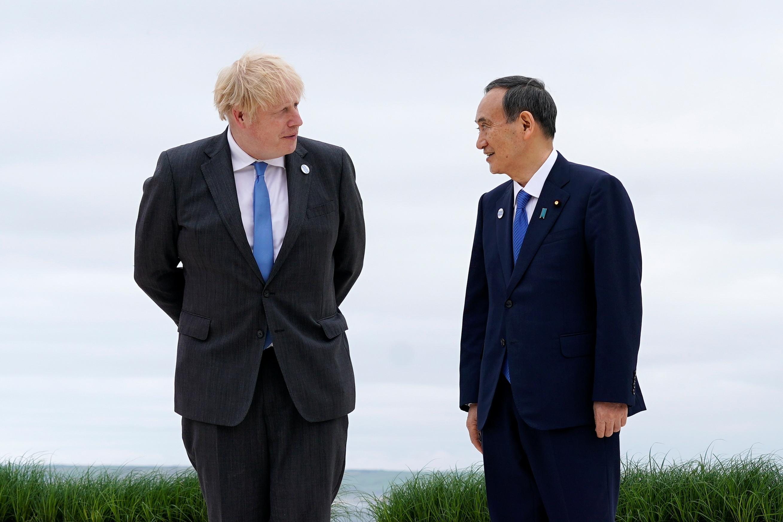 ▲▼日本呼籲G7成員國支持如期舉辦下個月的東京奧運,圖為英國首相強生、日本首相菅義偉。(圖/路透社)