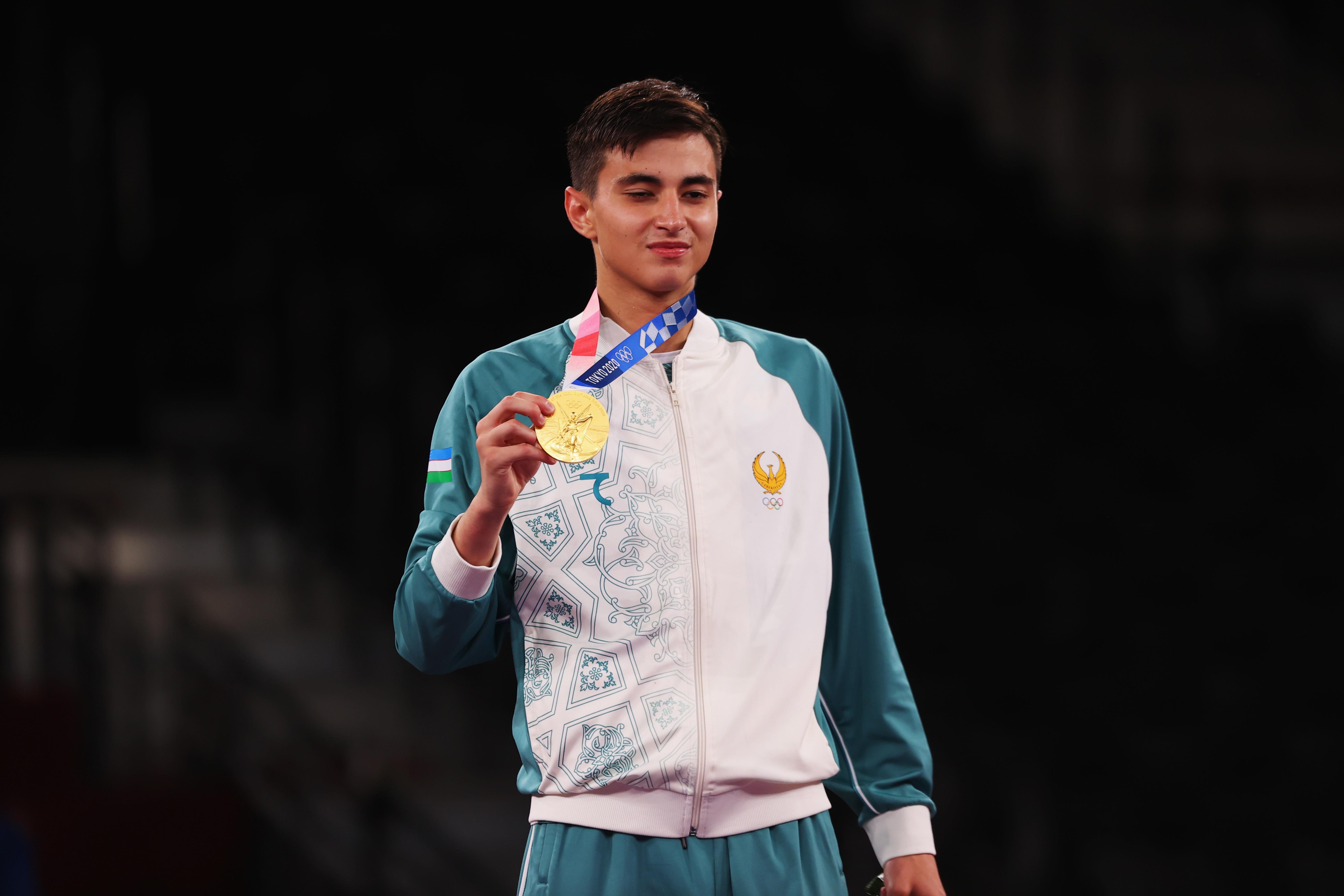 ▲▼烏茲別克跆拳道選手拉希托夫奪下金牌,為該國跆拳道史上的首面獎牌。(圖/路透社)