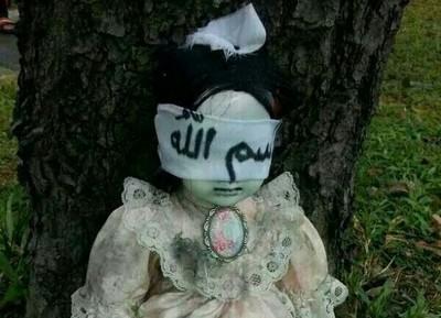 看到路邊的矇眼娃娃,千萬別拆下布條
